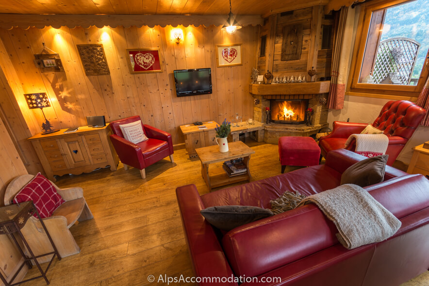 Apartment Biollet Samoens Living area with comfortable sofas and a roaring log fire
