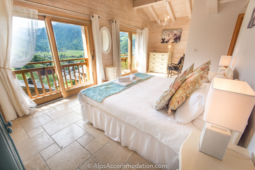 Chalet Falcon Samoens The wonderful double height ensuite master bedroom featuring a king bed, additional single, and amazing mountain views