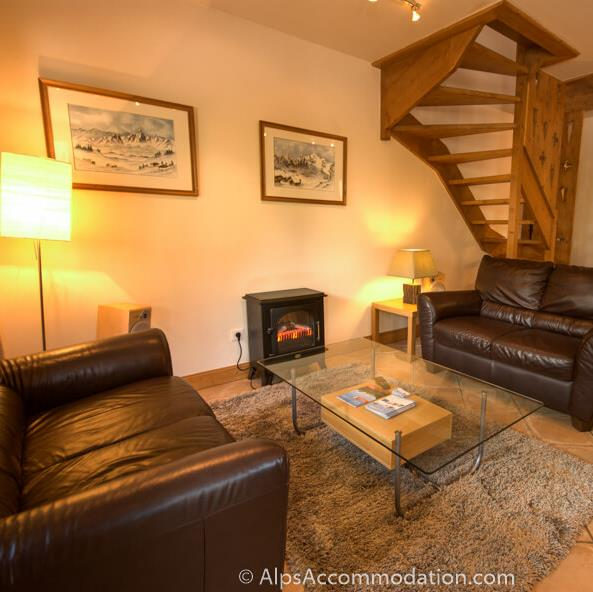 Villa Monette B1 Samoens The first lower lounge with comfortable leather sofas and electric fire