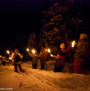 Torchlight snowshoe walk followed by fondue in a Yurt!