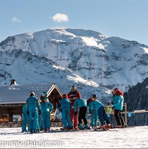 Group ski lessons with a stunning backdrop